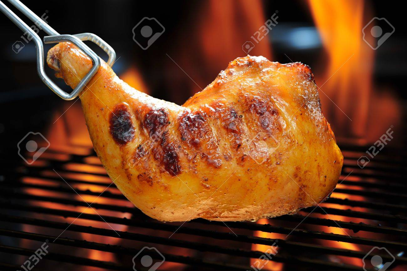 Grilled chicken thigh on the flaming grill - 18537946