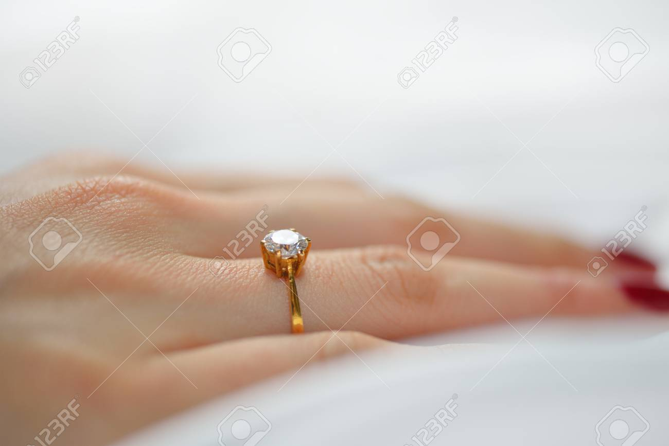 Wedding Ring On Hand Of Bride On White Cloth Stock Photo Picture
