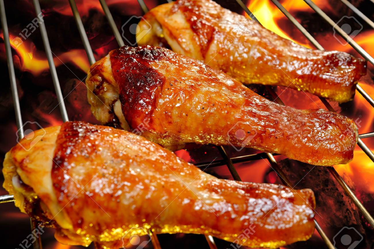 Grilled Chicken Legs On The Flaming Grill Stock Photo, Picture And ...