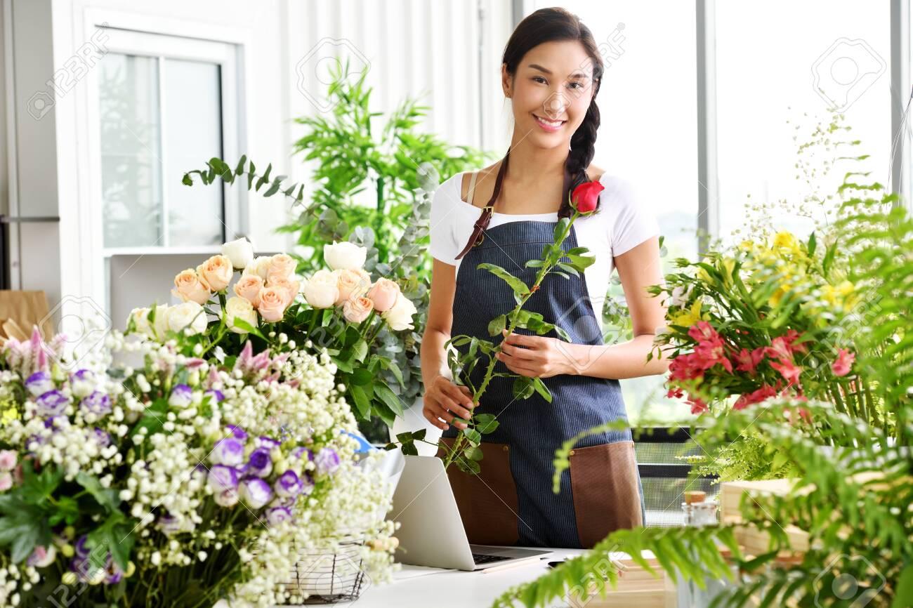 Young Asian woman entrepreneur/shop owner/ florist of a small flower shop business - 129195605