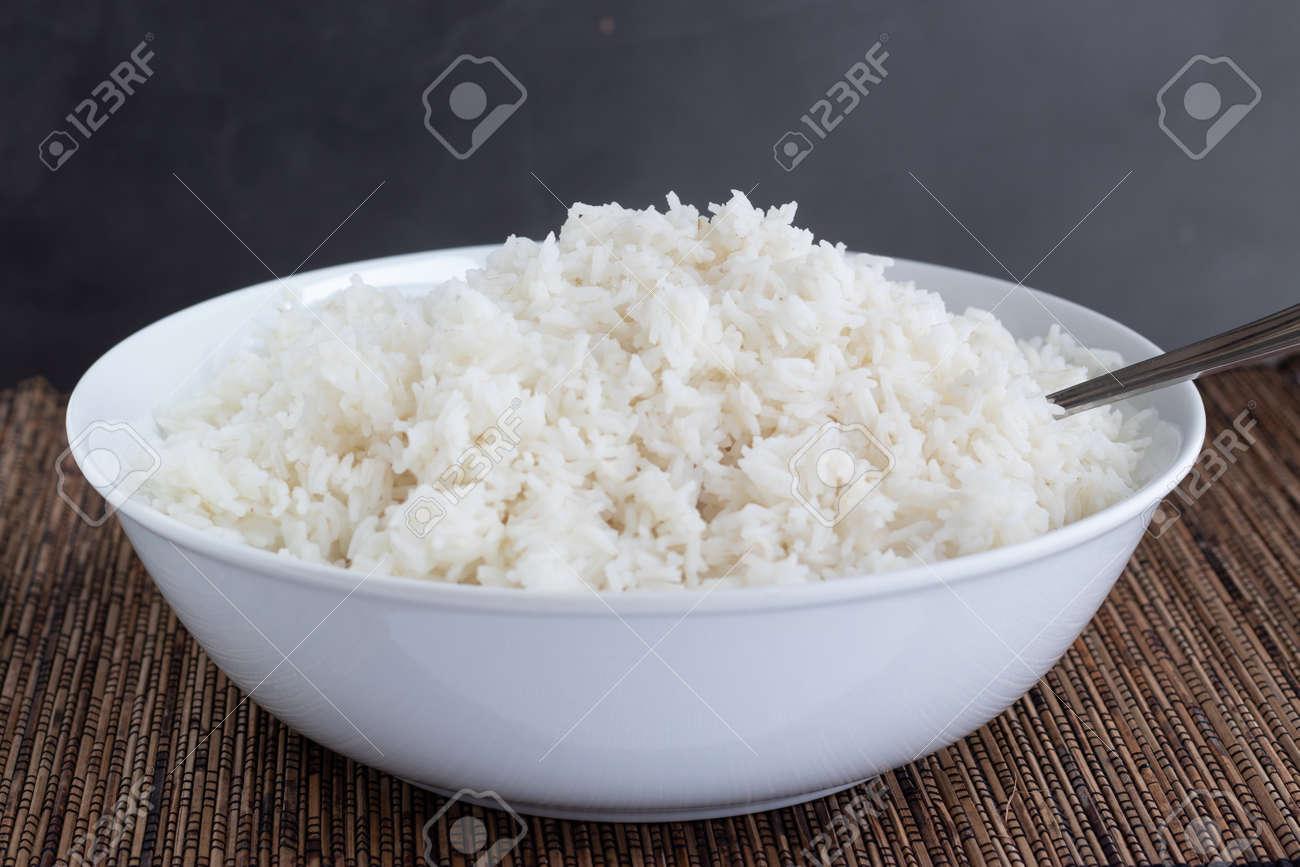 Rice bowl on a dark background - 165866134