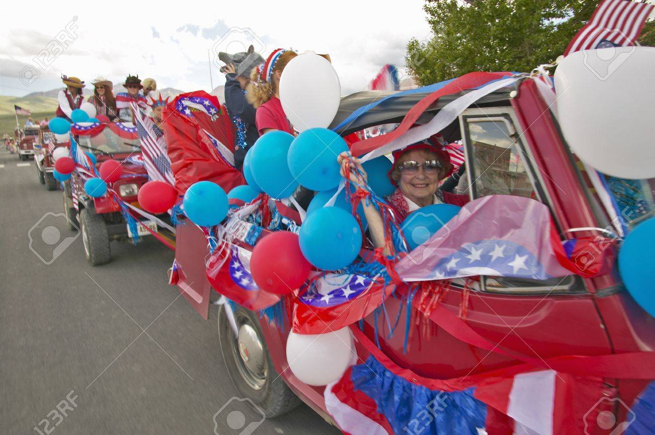 Cars decorated in red, white & blue for Independence Day Parade, in Lima Montana Stock Photo - 19962159