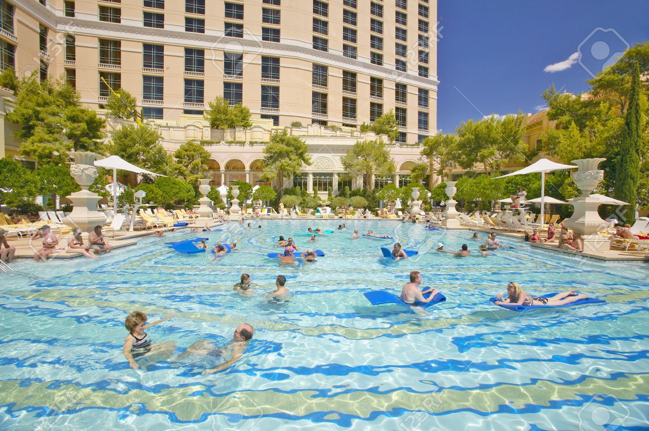 Bellagio las vegas bellagio hotel las vegas - Large Swimming Pool With Swimmers At Bellagio Casino In Las Vegas Nv Stock Photo
