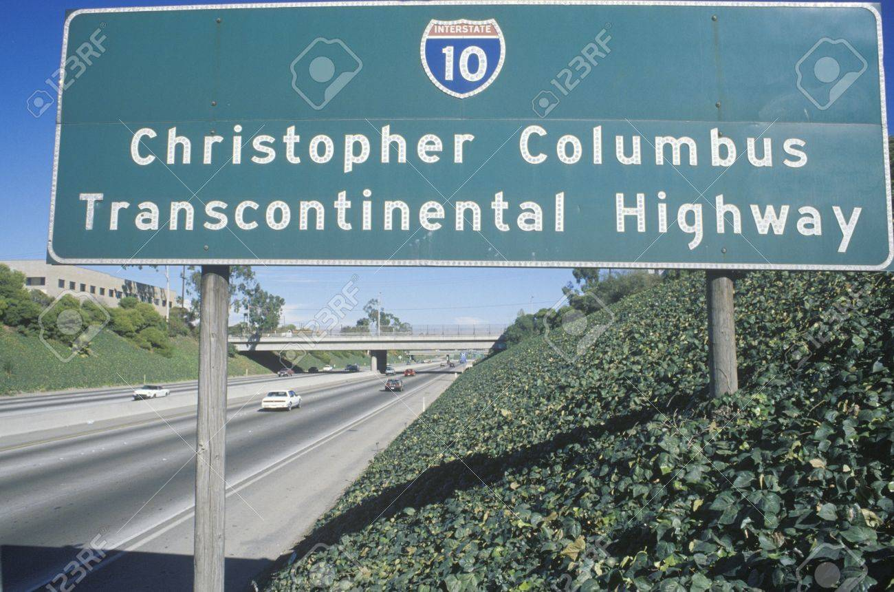 a sign that reads òchristopher columbus transcontinental highwayó
