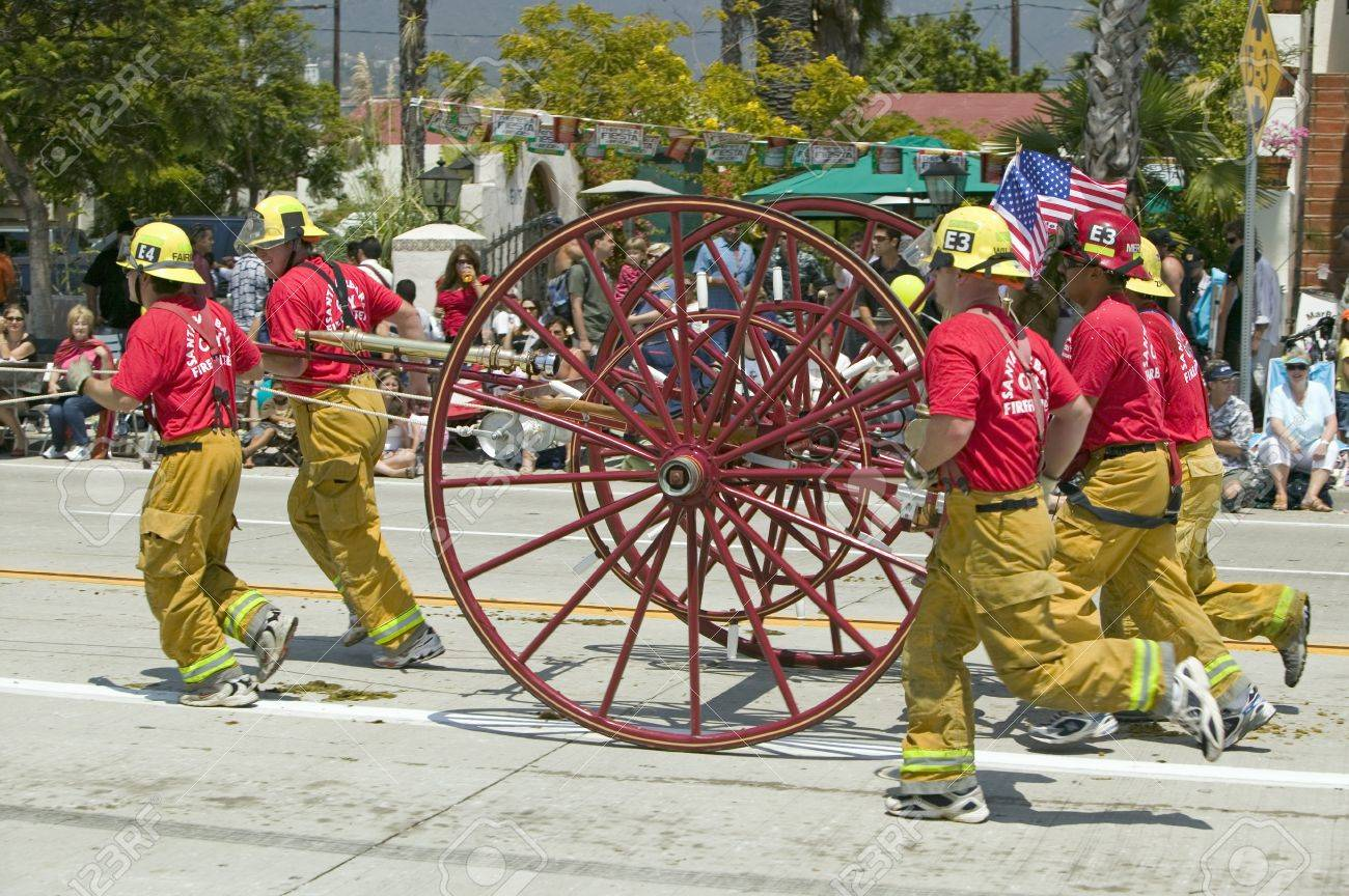 Santa Barbara Fire Department pulling old fire engine during opening day parade down State Street, Santa Barbara, CA, Old Spanish Days Fiesta, August 3-7, 2005 Stock Photo - 20474479