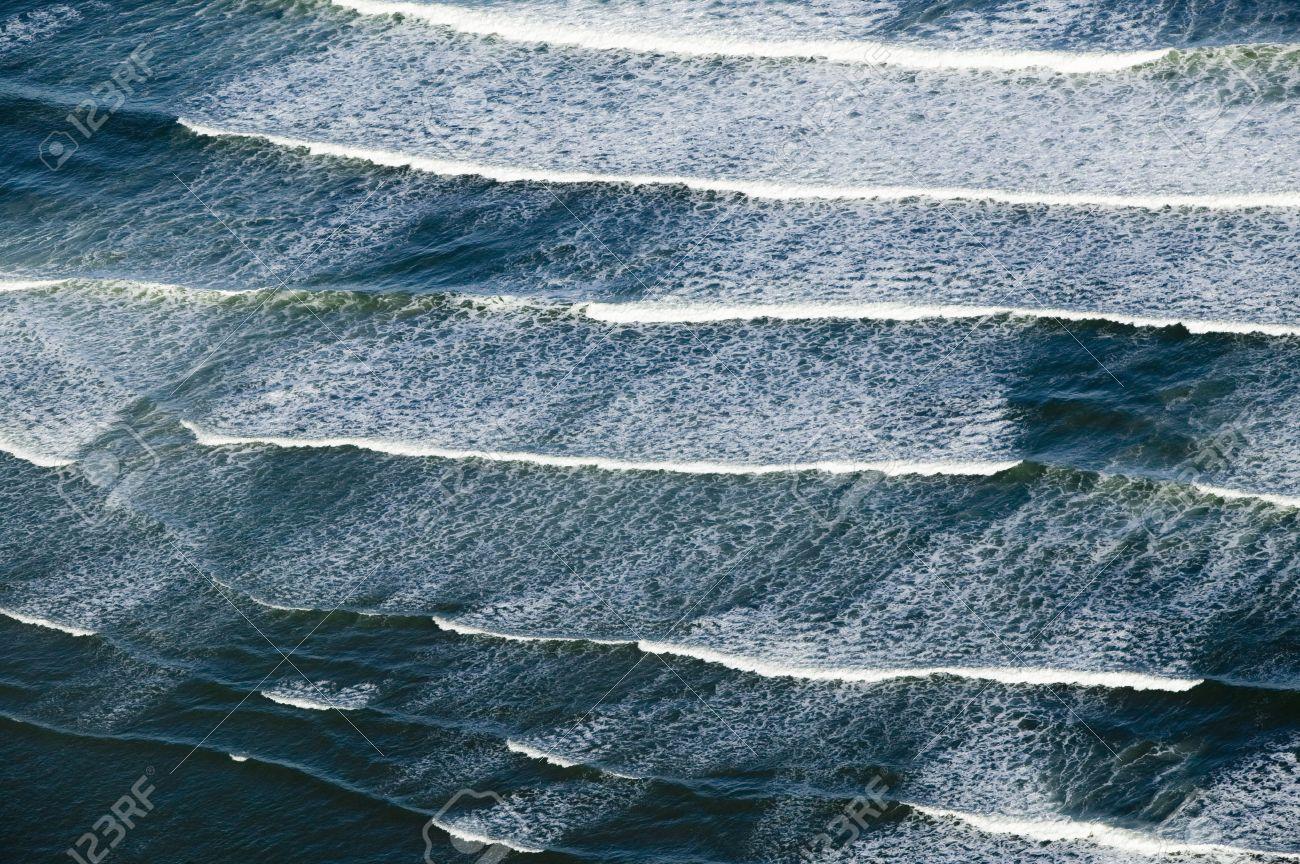 Views Of The Ocean aerial view of breaking ocean waves south of portland, maine stock