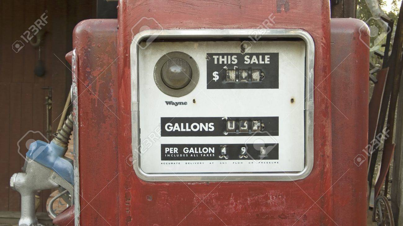 Antique red gas pumps in front of old gas station in Malibu,