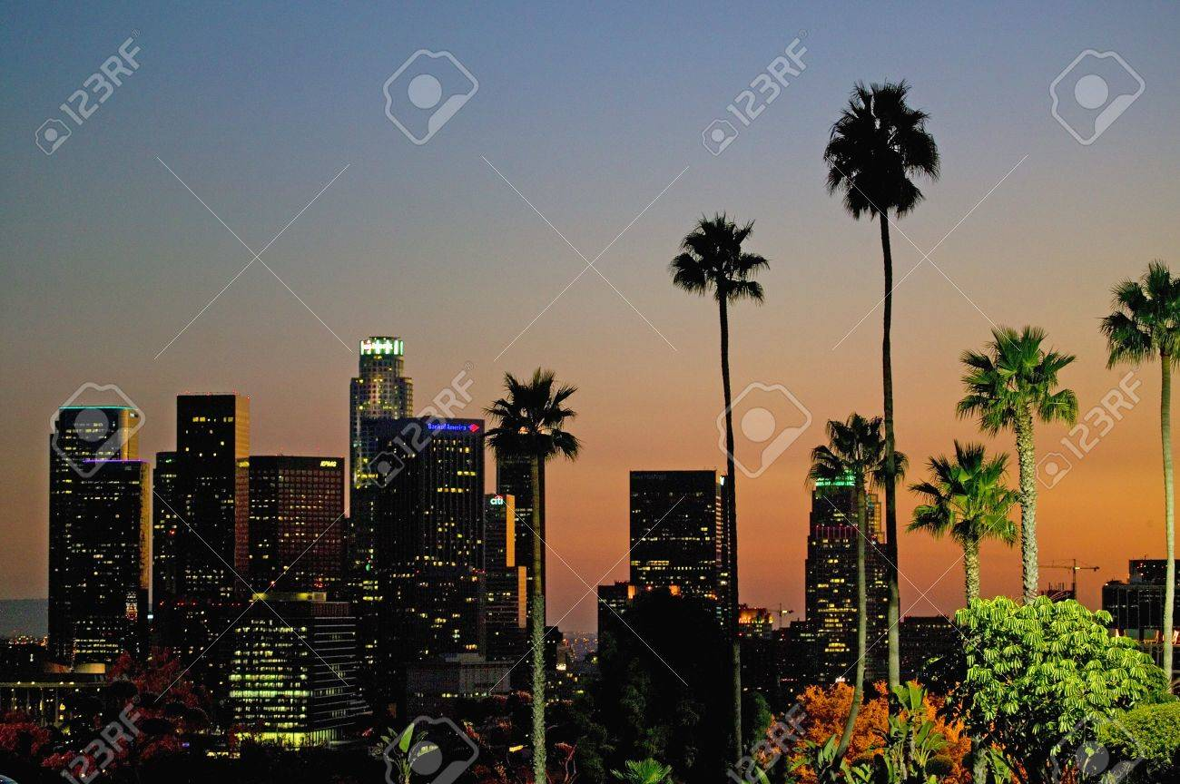Palm trees at sunset rise above Los Angeles skyline as seen from Dodger Stadium during NLCS baseball series, October 12, 2008 Stock Photo - 20512255
