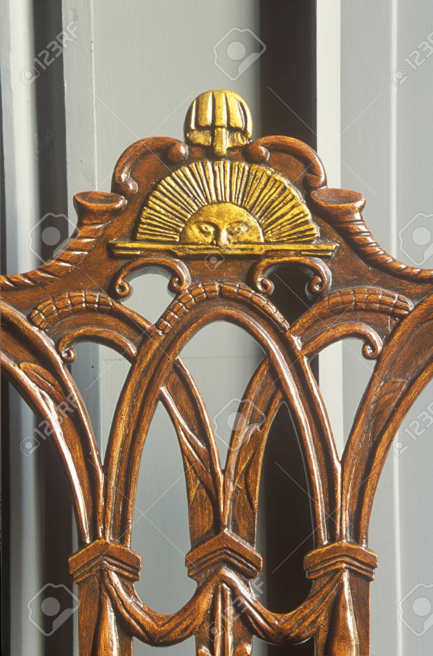 Early American Hand Carved Chair With Sun Design Stock Photo   20713404