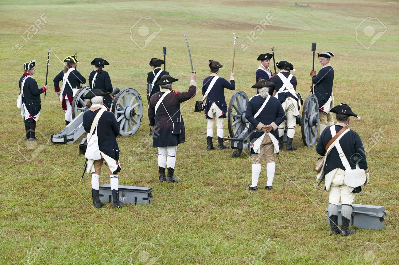 Revolutionary War re-enactors re-create the cannon fire and subsequent