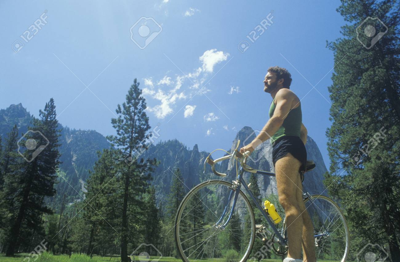 Man riding road bicycle in Yosemite, CA