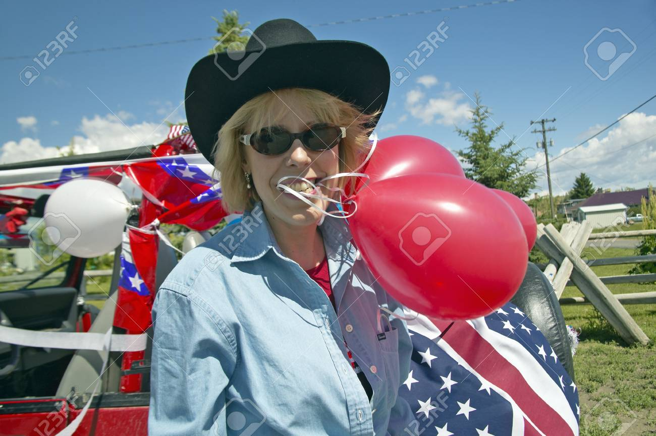 Woman with balloons and decorated red, white and blue car in Lima Montana Stock Photo - 20713672