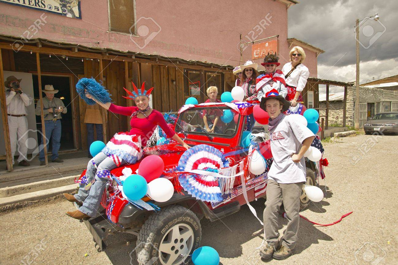 Teenagers riding a jeep decorated for the Fourth of July, in Lima Montana Stock Photo - 20713675
