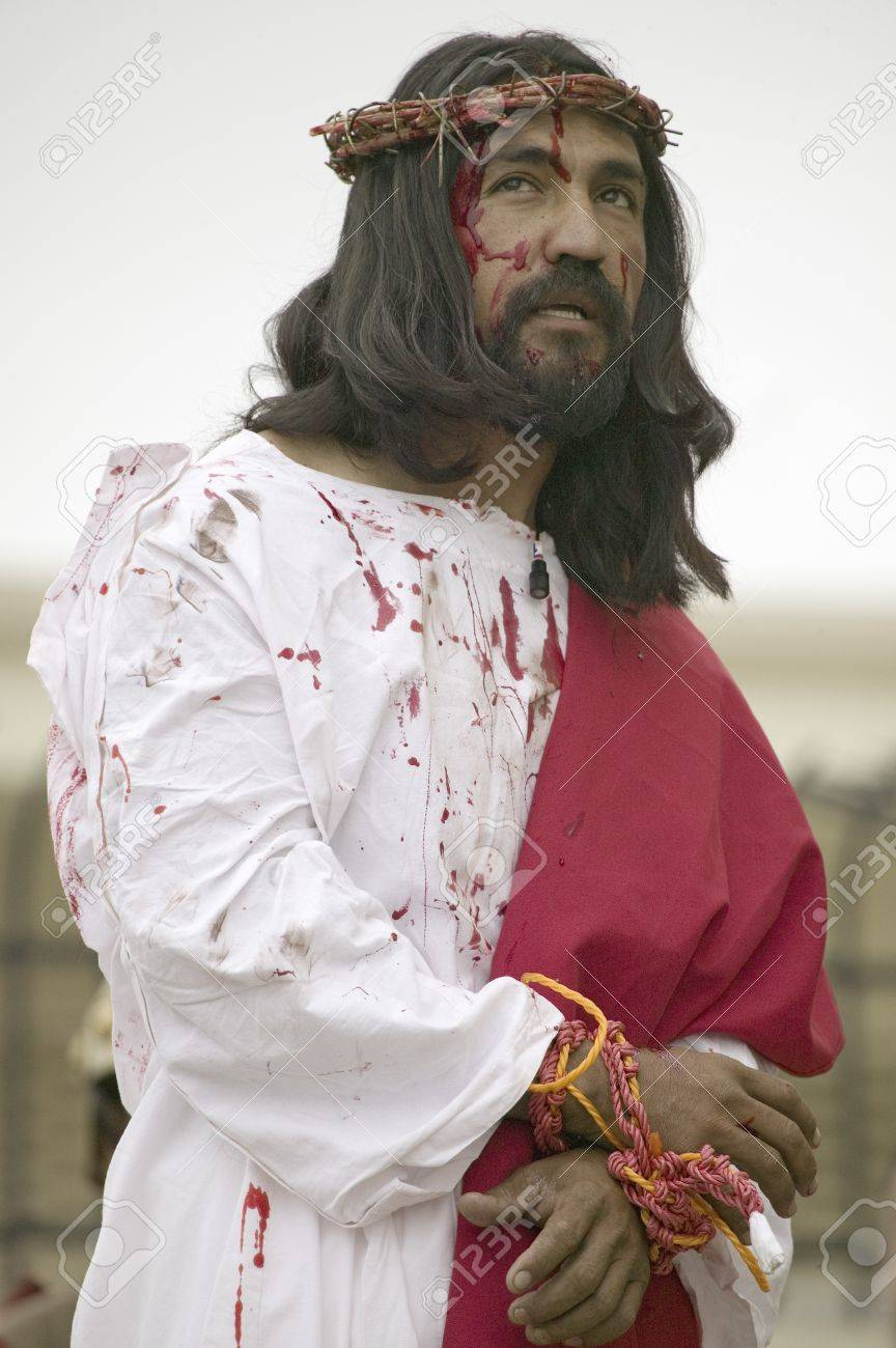 Close-up of an actor portraying Jesus Christ with blood on his face on Good Friday, Easter, during the Passion play, a dramatic reenactment of the trial, torture and death of Jesus Christ at Christ the King Church and Our Lady of Guadalupe Parish, Oxnard, Stock Photo - 20801578