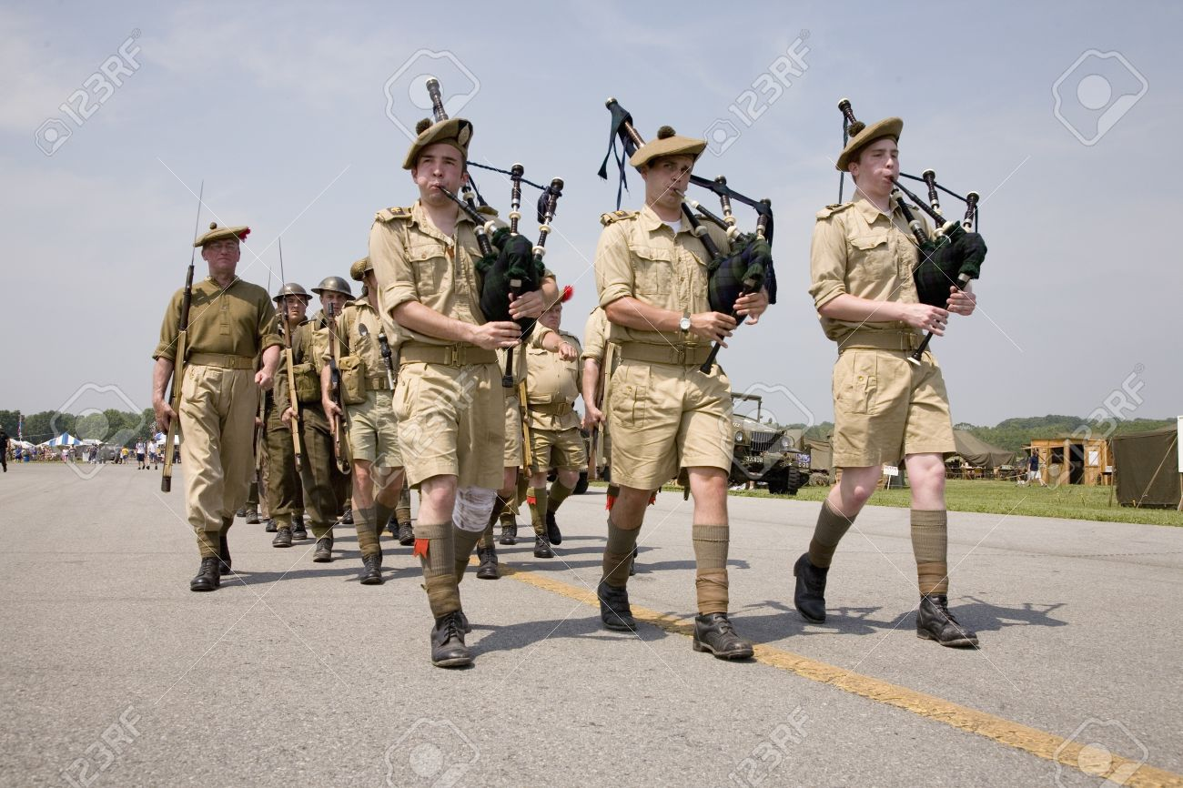 World War II reenactment of marching troops playing bagpipes