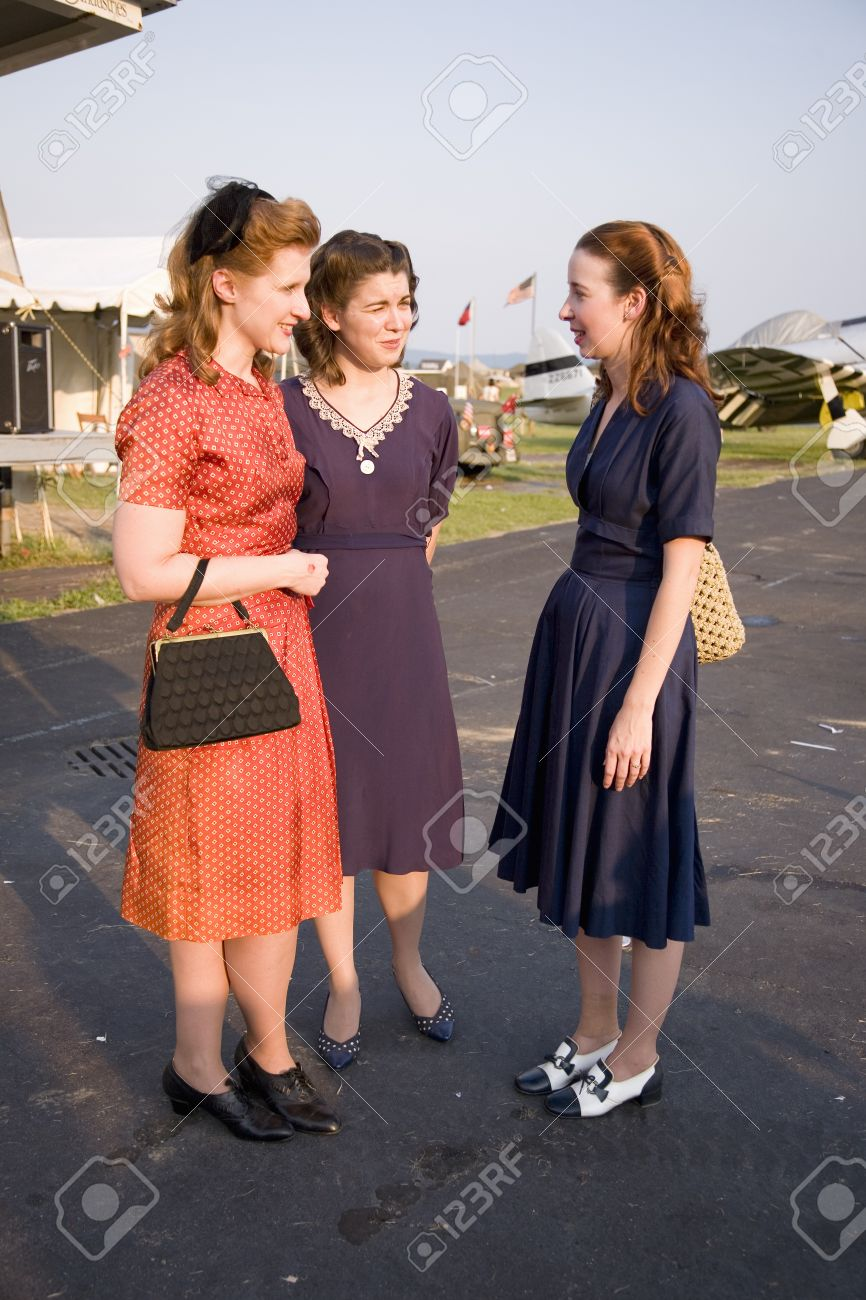 three women wearing old fashioned 1940s dresses at mid atlantic