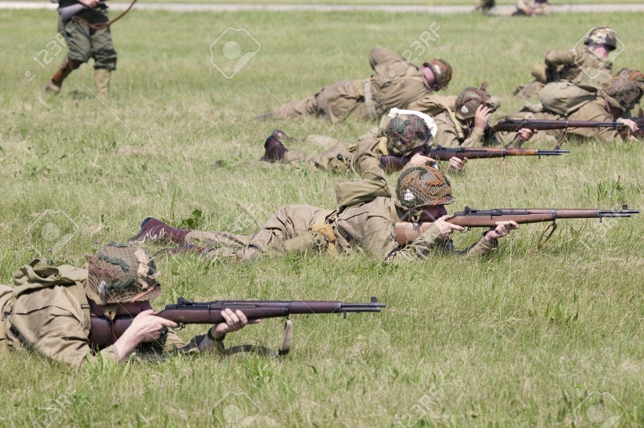 World War II reenactment of a battle between American infantryman