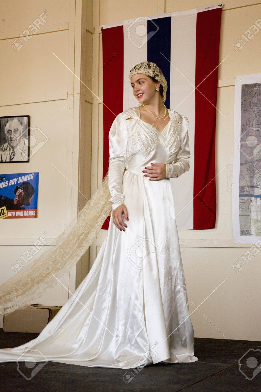 Bride In 1940s Wedding Dress Posing In Front Of Flag During A
