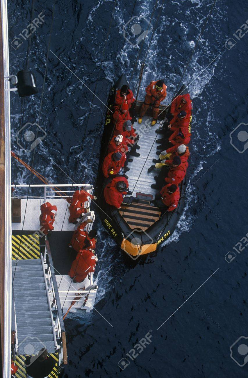 Ecological tourists enter inflatable Zodiac boat from cruise