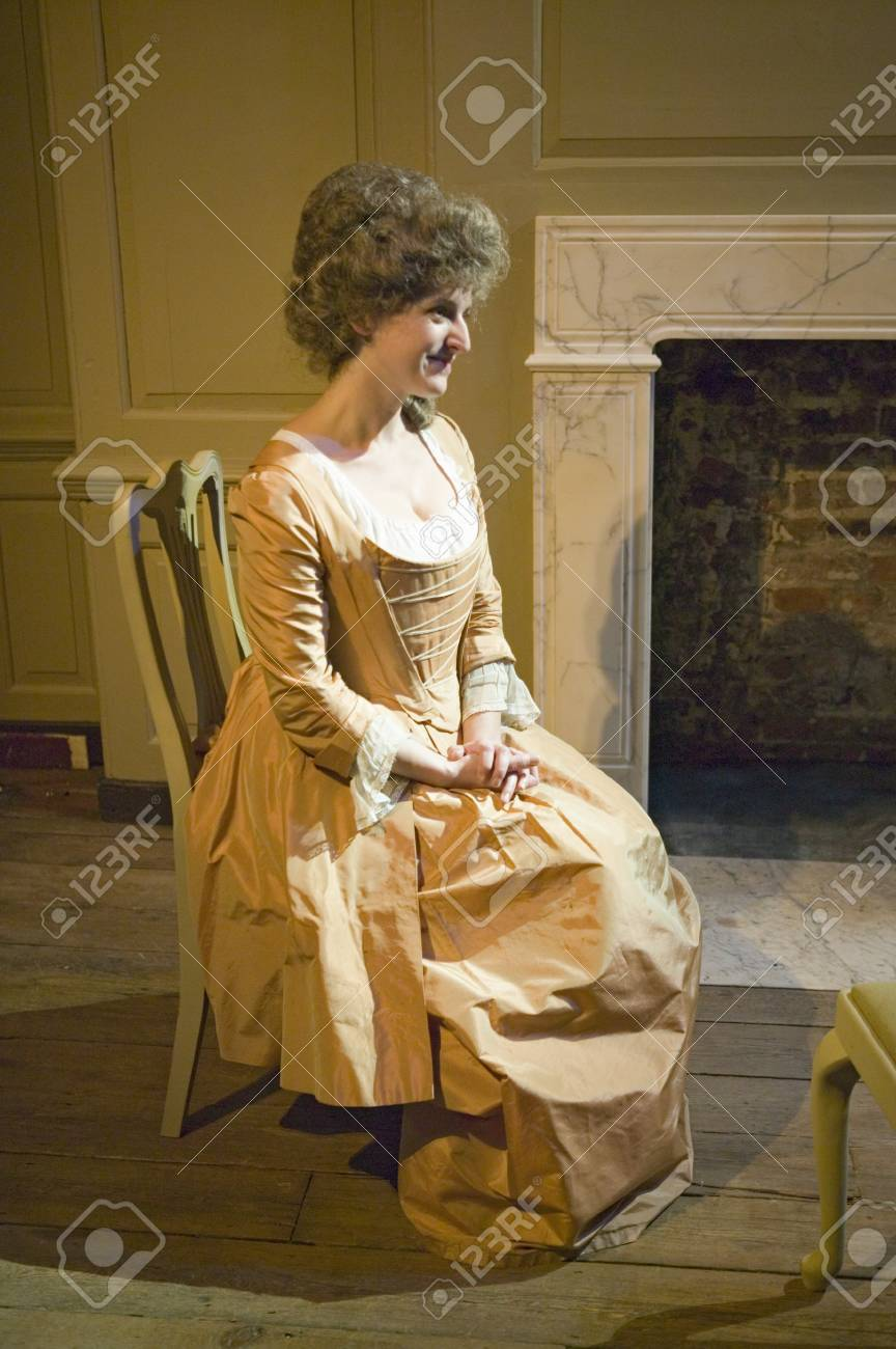 Reenactor sits in the Benjamin Franklin House, the world's only remaining Franklin home. For nearly sixteen years between 1757 and 1775, Dr Benjamin Franklin - scientist, diplomat, philosopher, inventor, Founding Father of the United States and more - liv Stock Photo - 20803209
