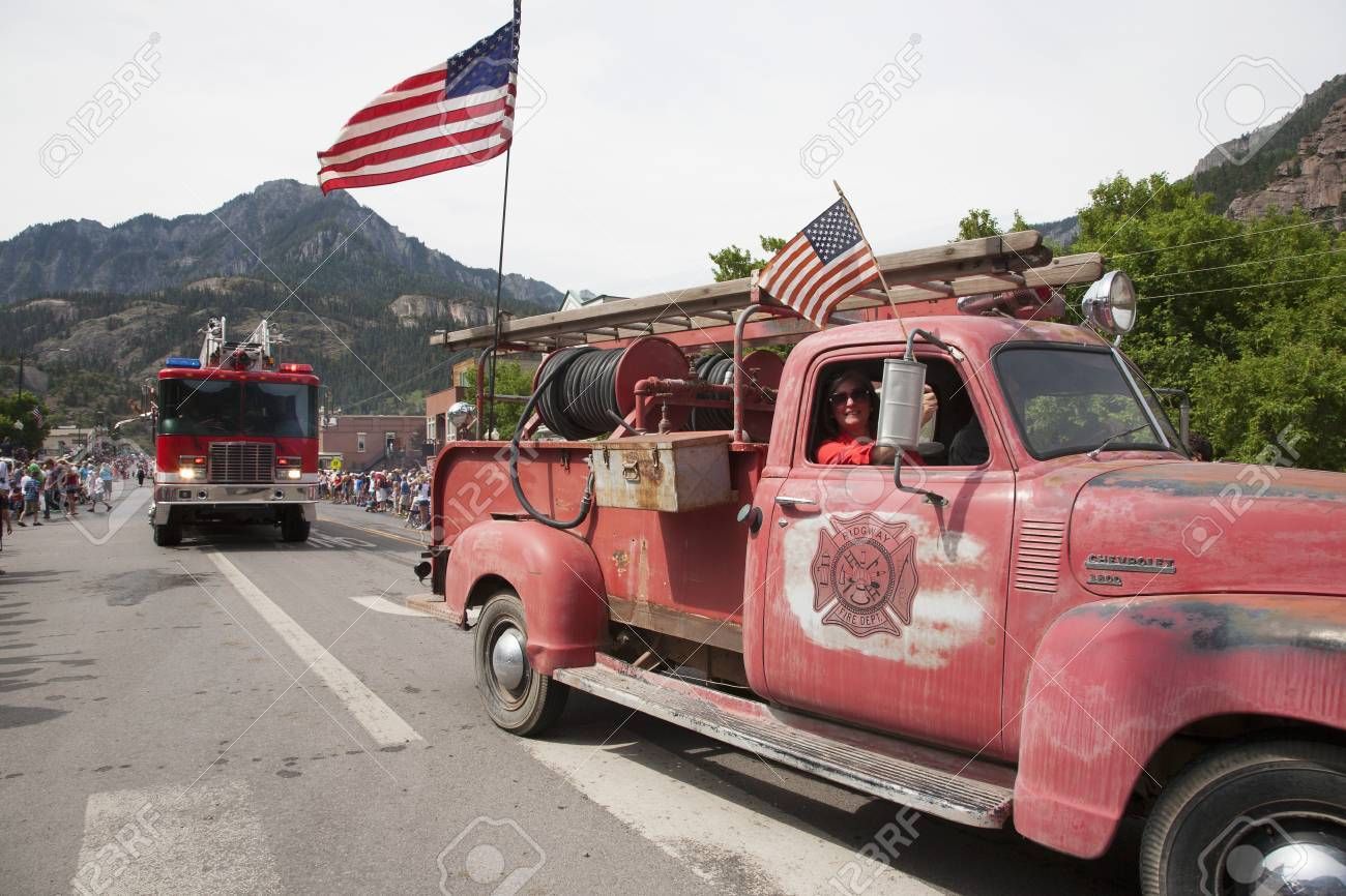 Antique Ridgway firetruck drives drives in July 4 Independence Day Parade, Ouray, Colorado