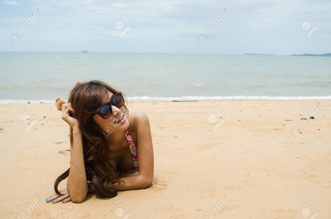 beautiful lady wear bikini laying on the beach Stock Photo - 23289982