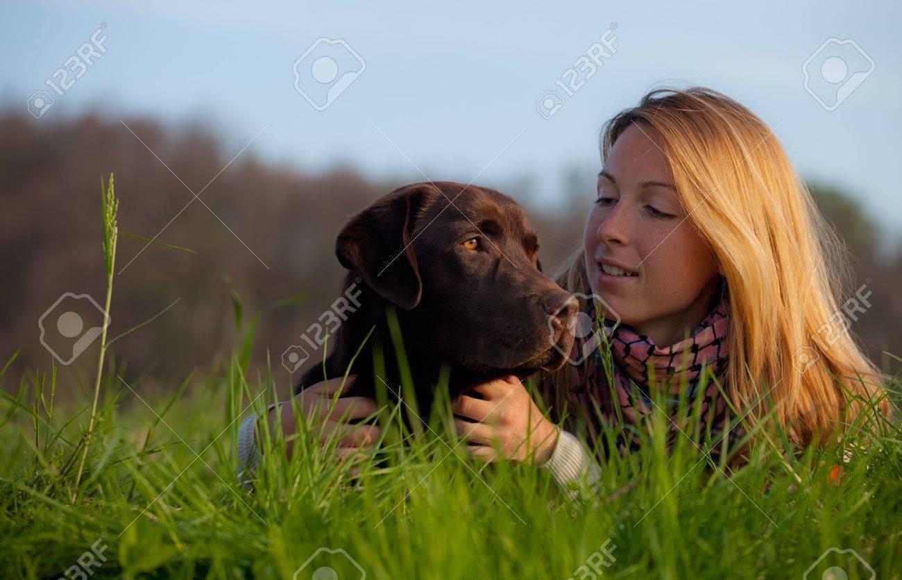 young woman and labrador dog Stock Photo - 13230648