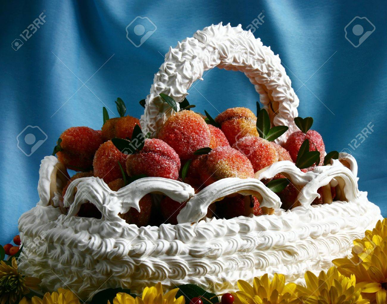 A Birthday Cake In The Form Of The Basket Of Peaches On A Blue