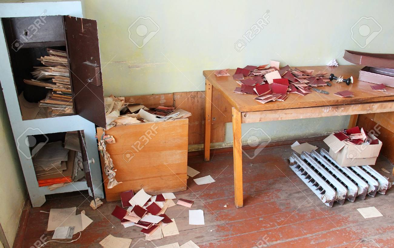 TSMINY, UKRAINE - OCTOBER 17: open a safe and documents scattered