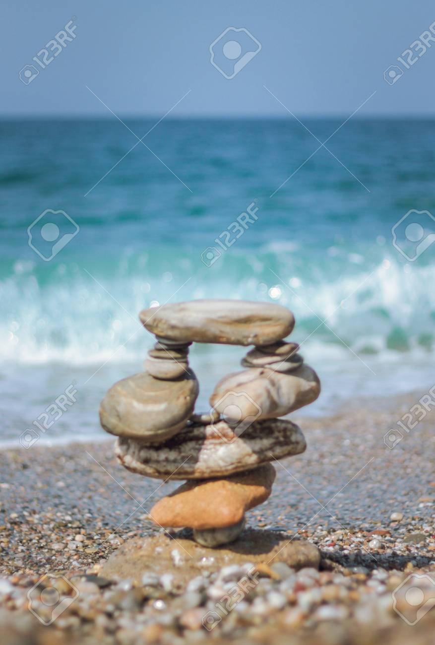 Symbol scales is made of stones of various shapes. Shallow depth of field. Stock Photo - 73478361