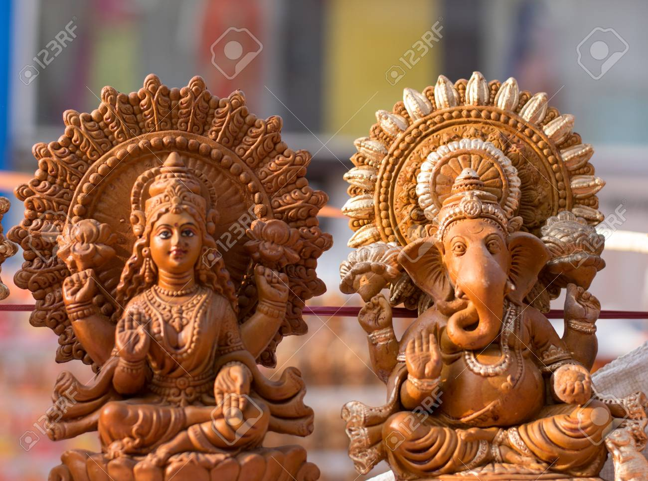 clay idols of laxmi and ganesh stock photo, picture and royalty free
