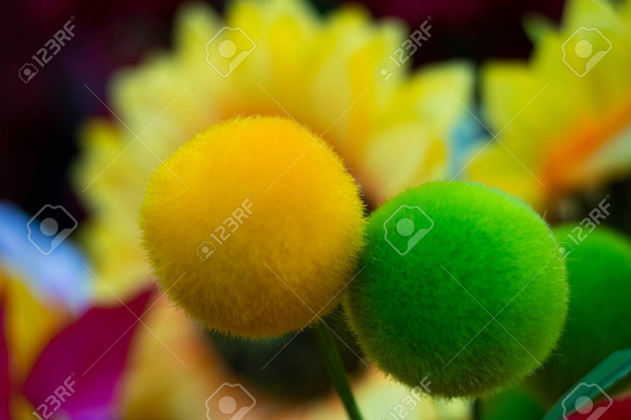Woolen flower balls green and yellow stock photo picture and stock photo woolen flower balls green and yellow mightylinksfo