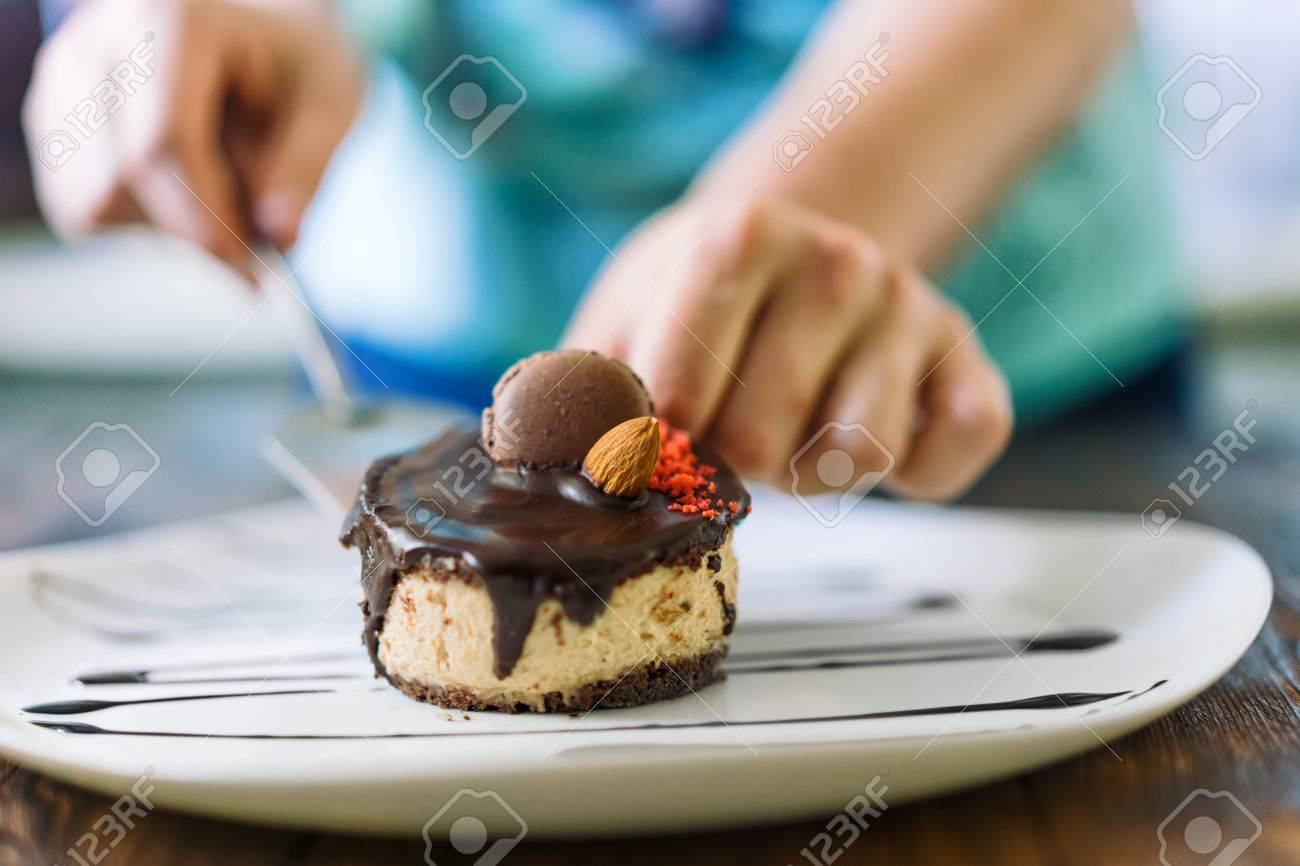 Female chef lays out a cake on a plate dessert presentation. Dessert decorated cookies & Female Chef Lays Out A Cake On A Plate Dessert Presentation ...
