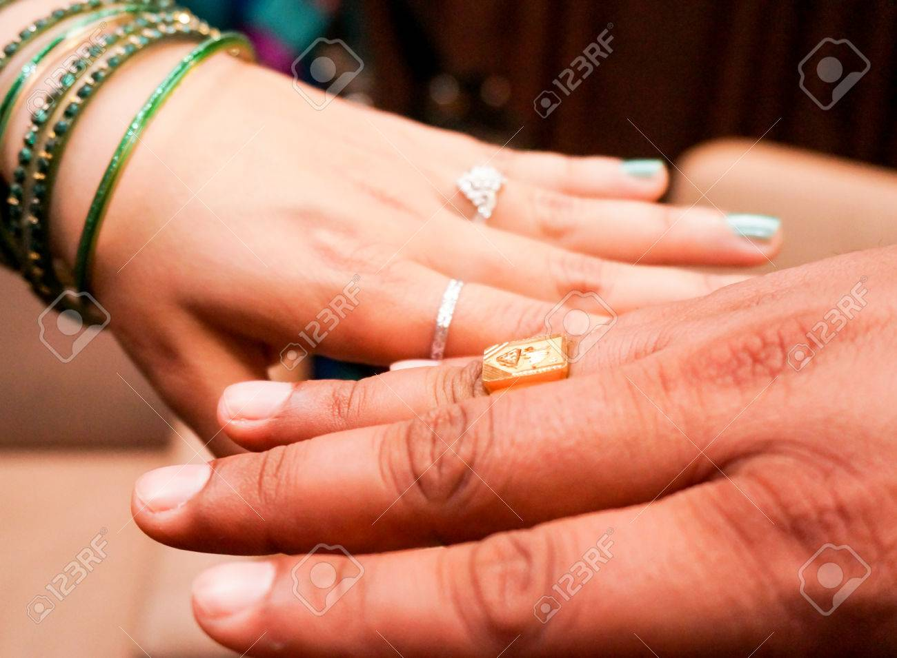 Indian Bride And Groom Wearing The Engagement Or Wedding Rings