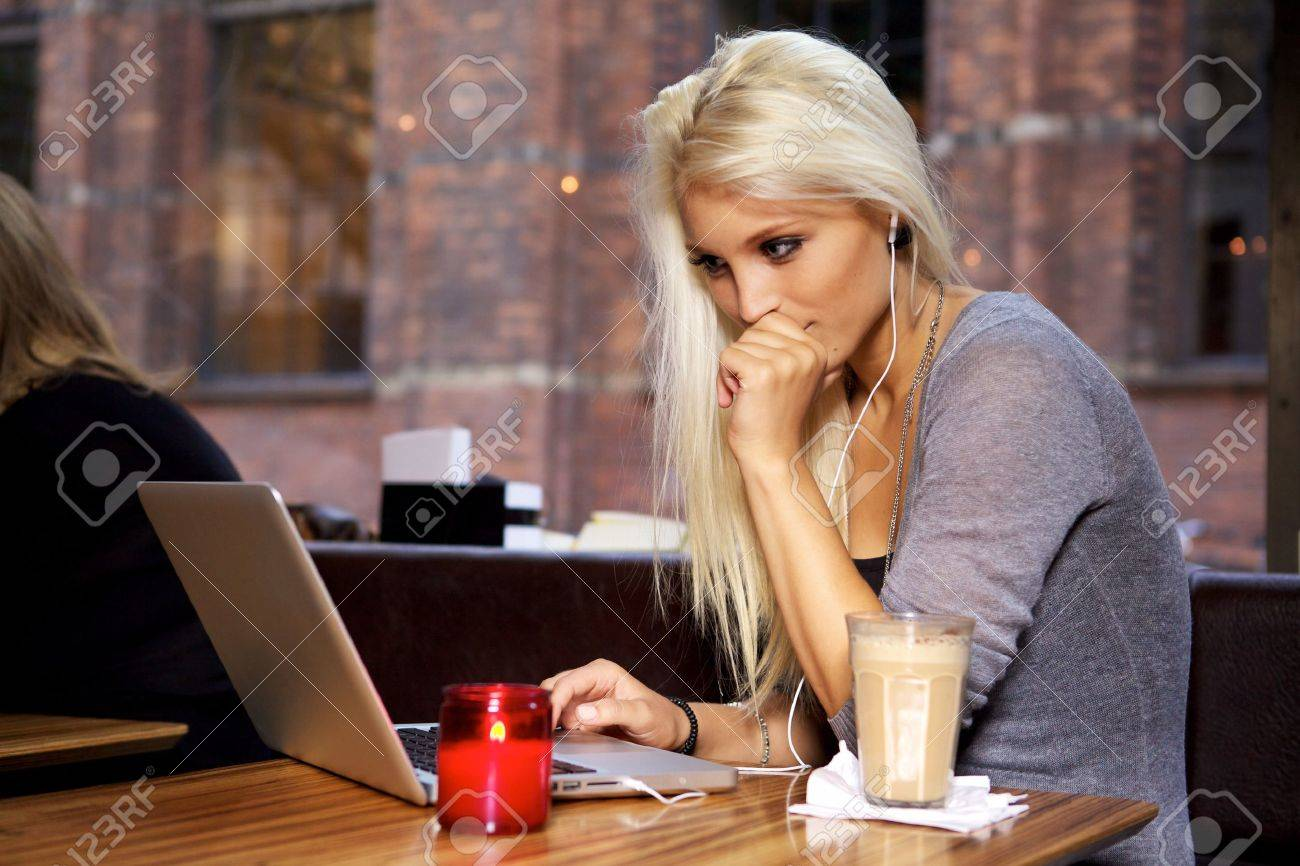 Beautiful young college student on a cafe. Stock Photo - 10586666