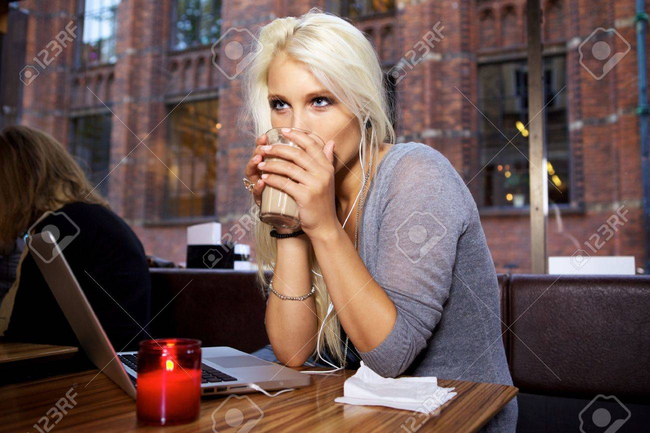 Portrait of a cute girl sitting on a cafe. Stock Photo - 10586665