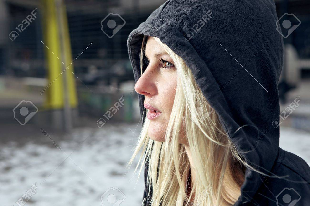 Sexy woman wearing a hooded cardigan outside in urban enviroment Stock Photo - 12663408