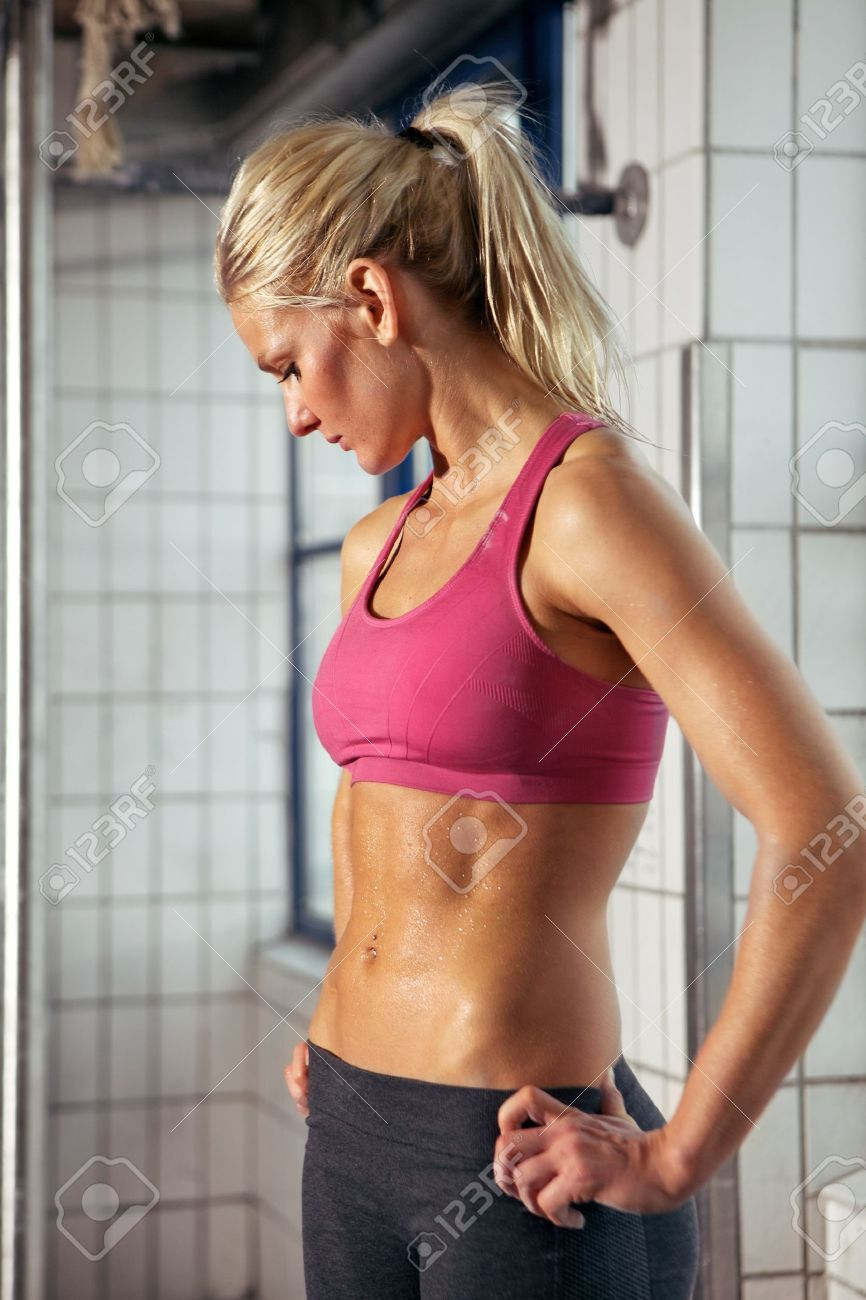 Portrait of a very fit woman having a break from her workout Stock Photo - 14157969