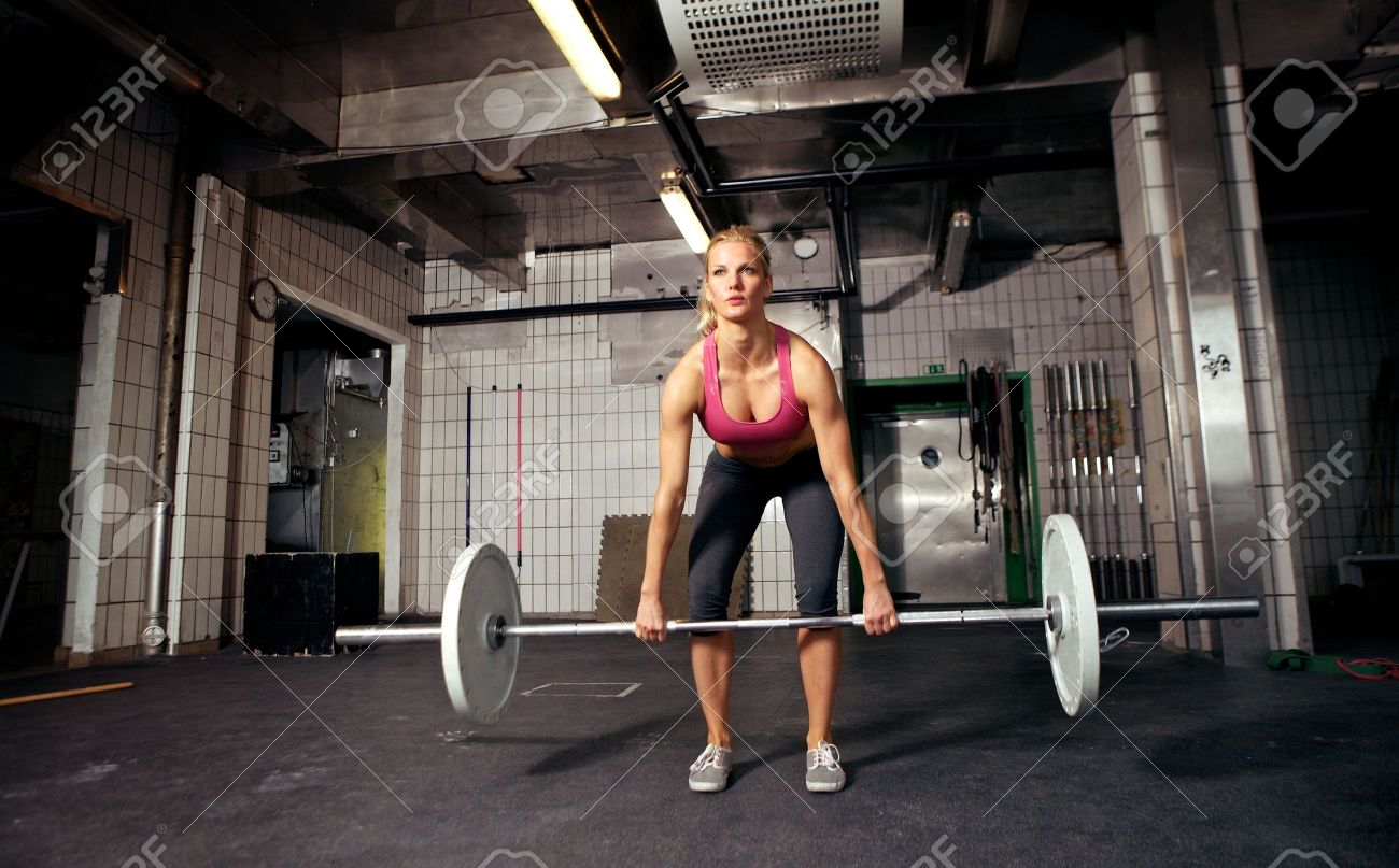 Female crossfit performing doing deadlift exercise with weight female crossfit performing doing deadlift exercise with weight bar stock photo 14157972 falaconquin