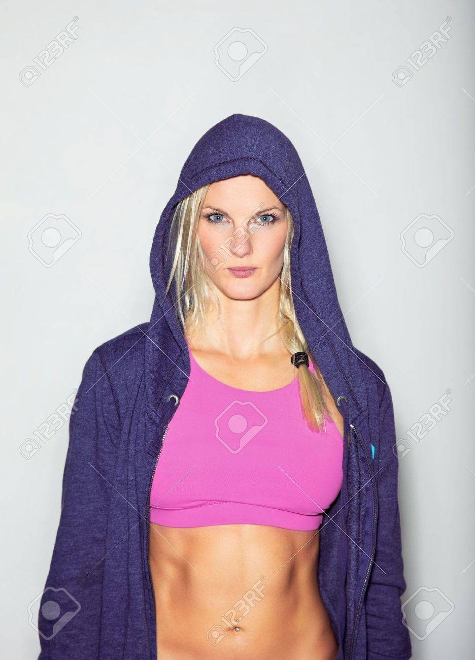 Confident woman in sportswear posing for camera against white background Stock Photo - 15865250