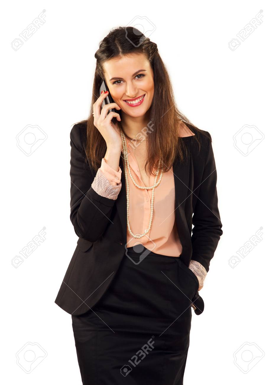 Happy career woman in a studio using her phone Stock Photo - 19146002