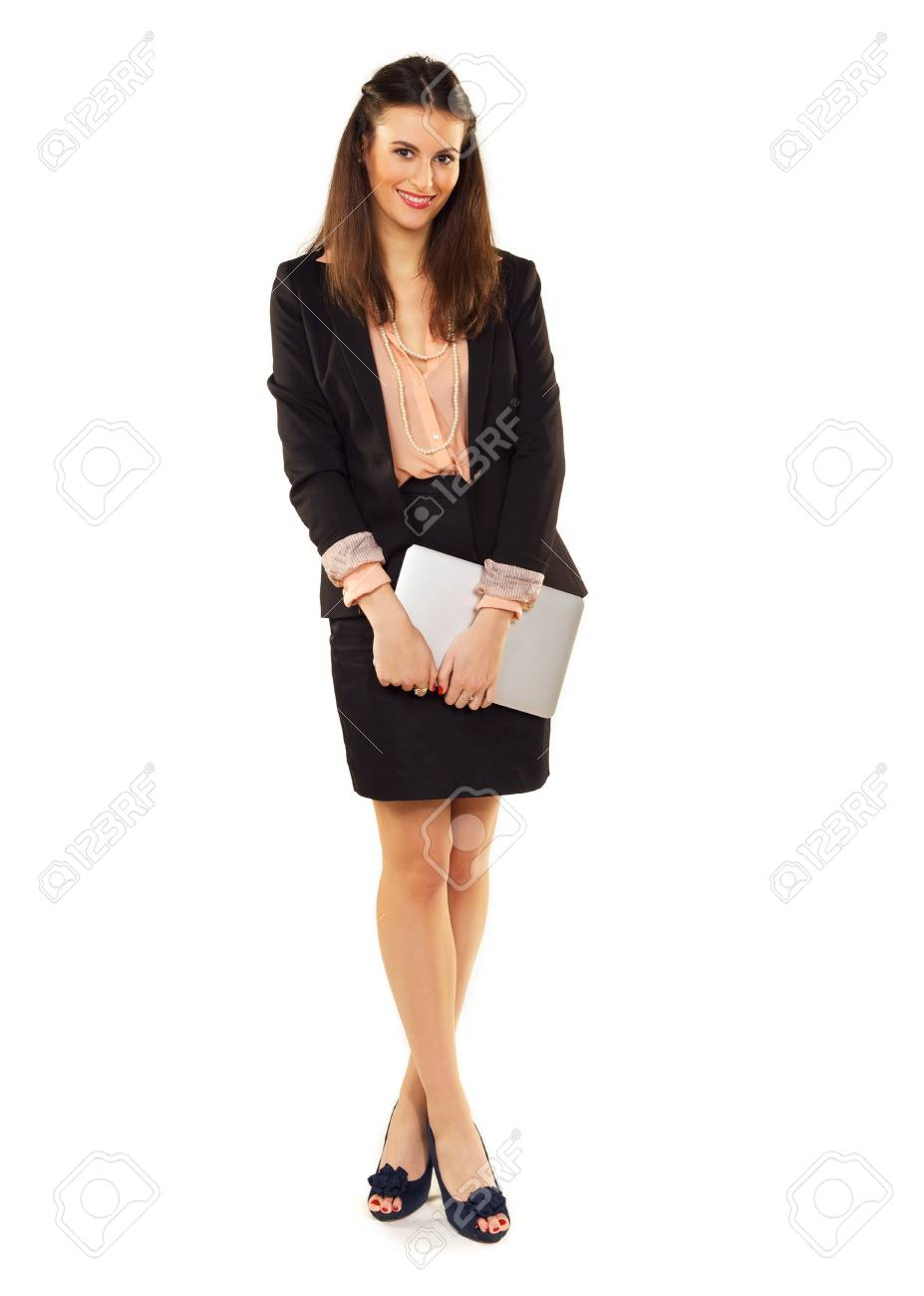 Cute office girl in a studio carrying her laptop Stock Photo - 19122154