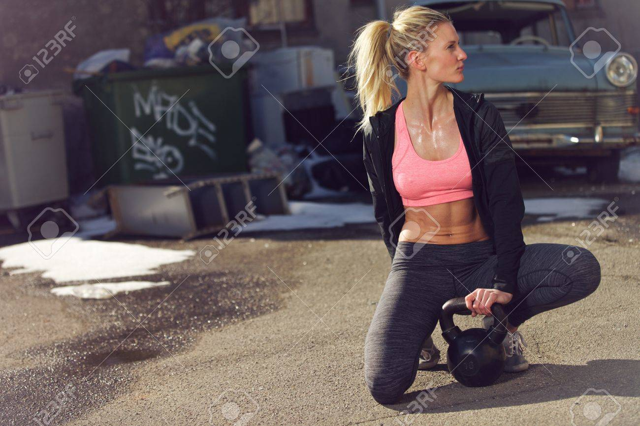 Tired woman outdoors resting after a crossfit training Stock Photo - 19564184