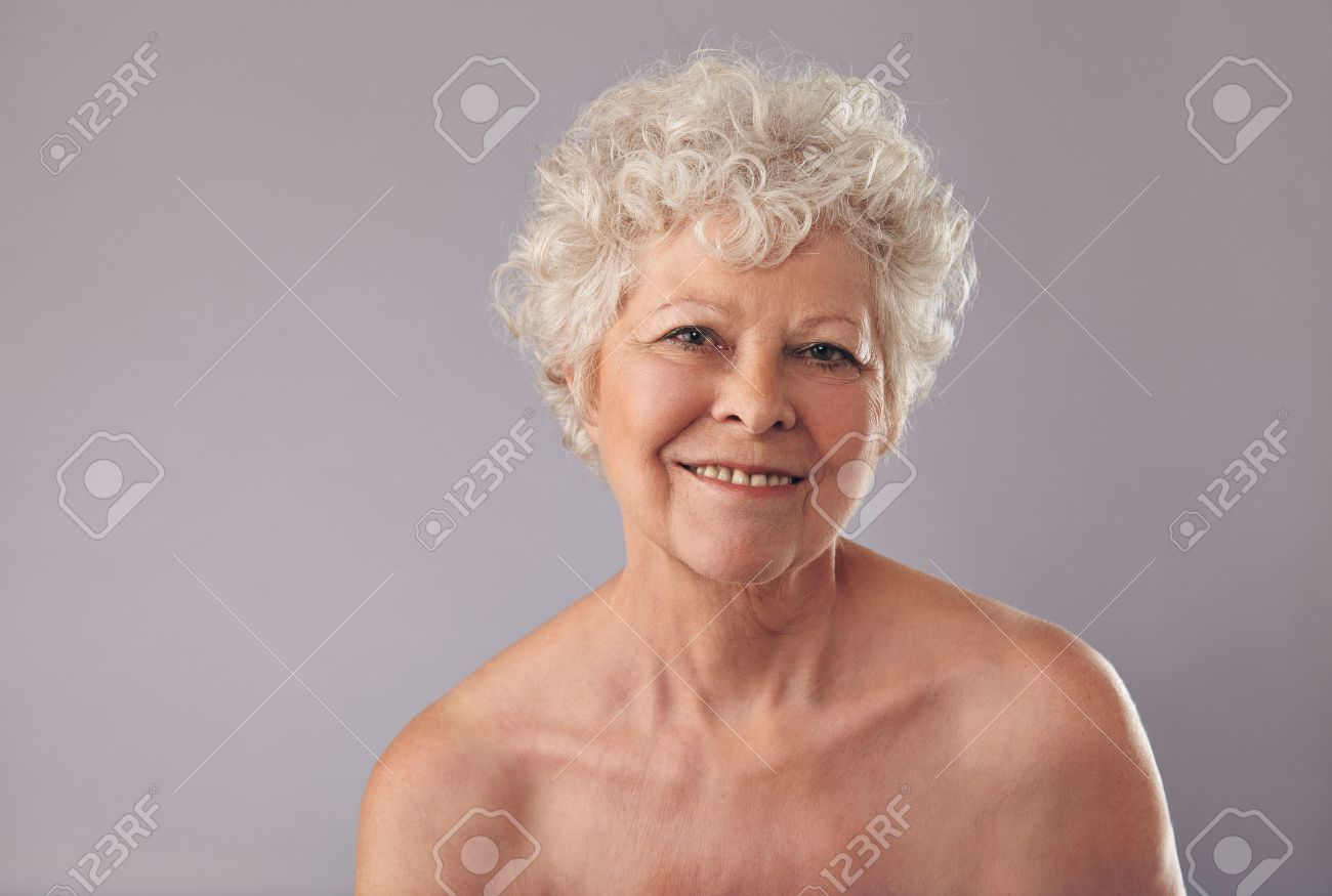 closeup of an attractive old lady with a sweet smile on her face