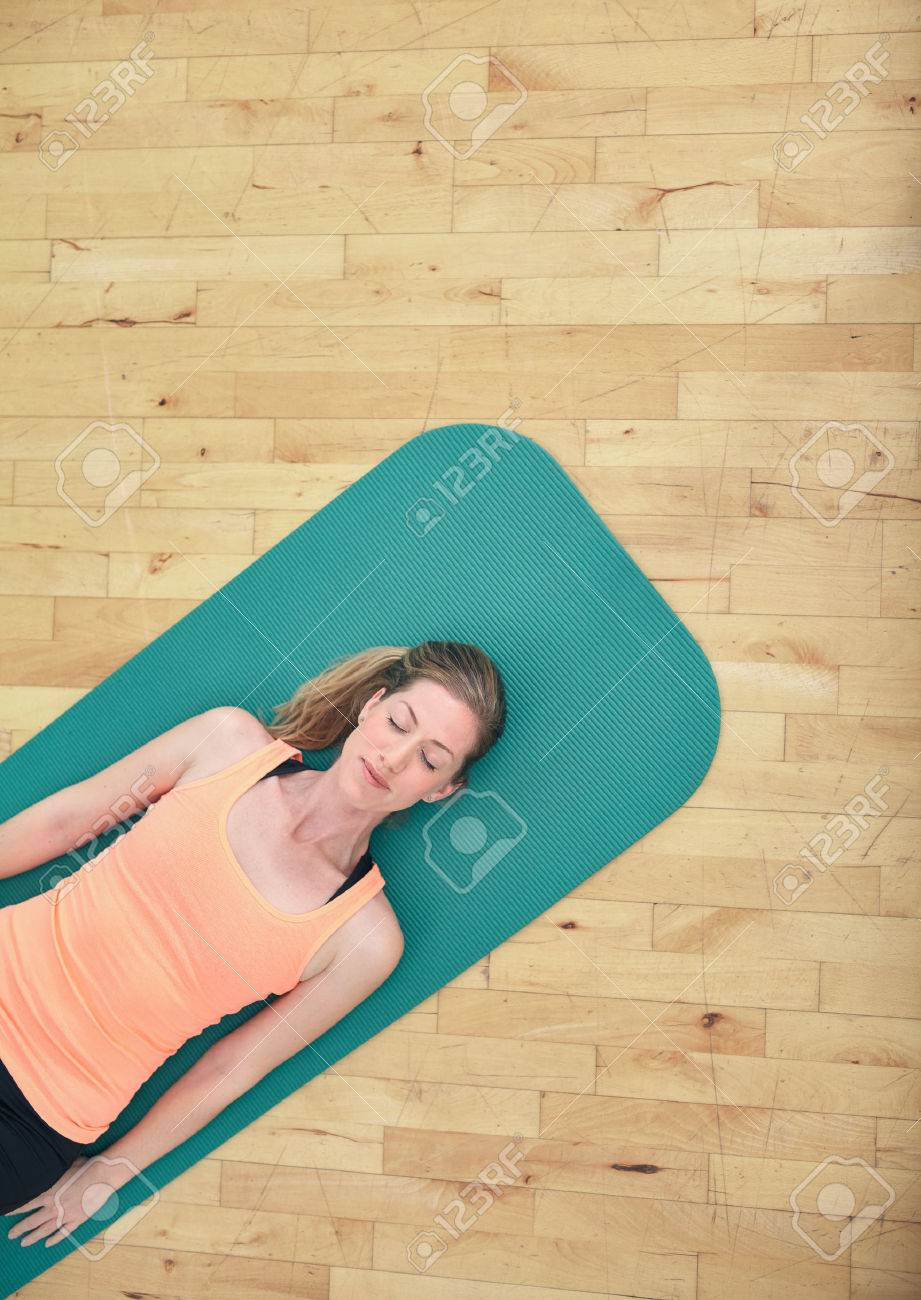 Top View Of Woman Relaxing On Yoga Mat With Copy Space Fitness