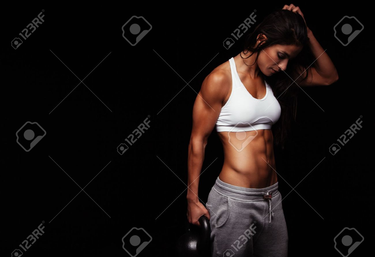 strength images stock pictures royalty strength photos and strength fitness w exercising crossfit holding kettle bell fitness instructor on black background