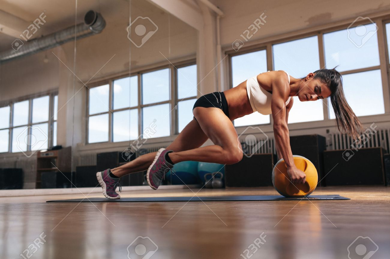 strength images stock pictures royalty strength photos and strength portrait of a fit and muscular w doing intense core workout kettlebell in