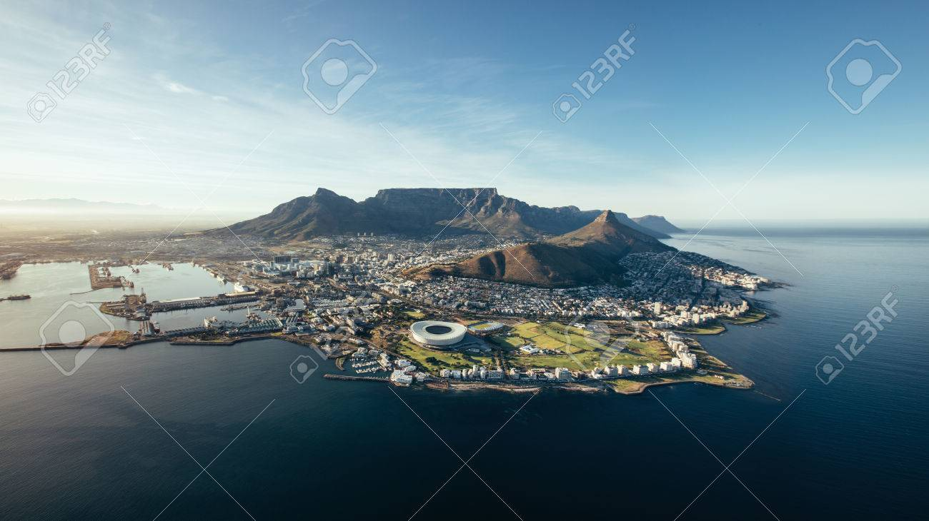 Aerial coastal view of Cape Town. View of cape town city with table mountain, cape town harbour, lion's head and devil's peak, South Africa. - 54739317