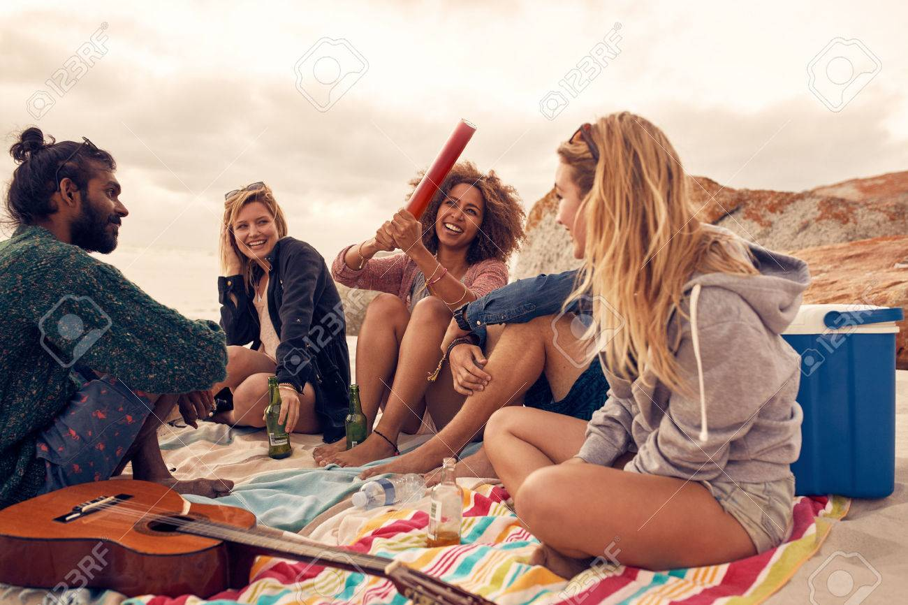 portrait of happy young people having fun at beach party group