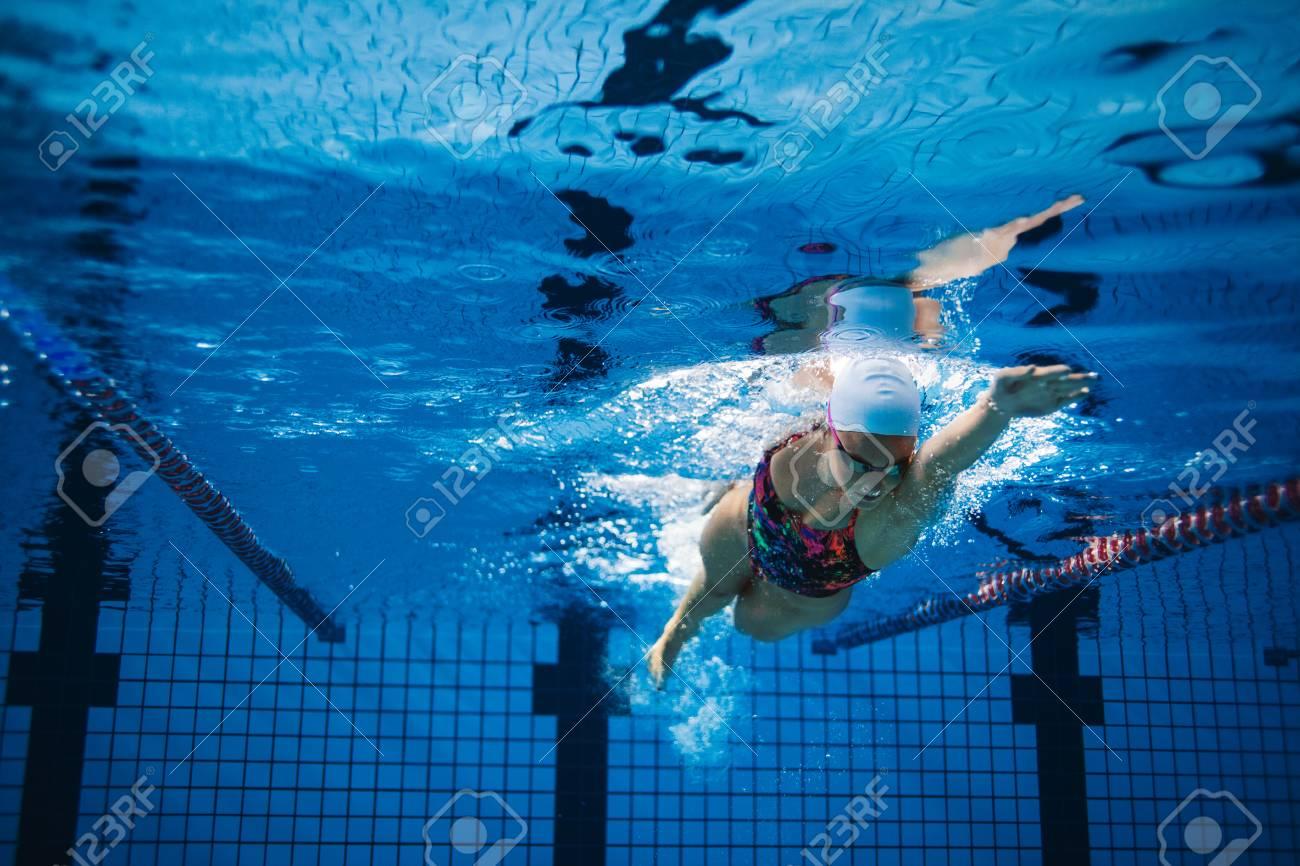 Underwater Shot Of Woman Training In Swimming Pool. Female Swimmer ...